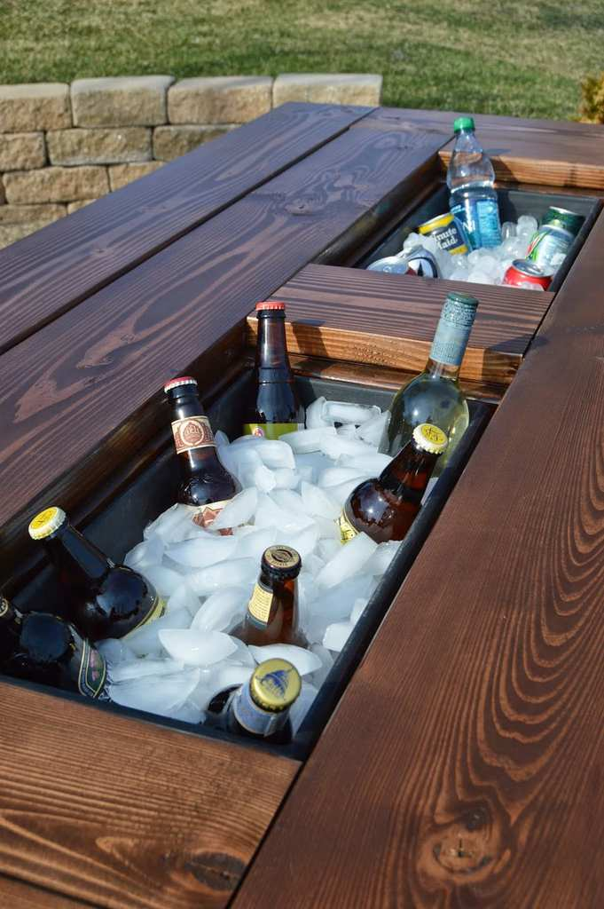 patio table using planter boxes for built in drink coolers kruses