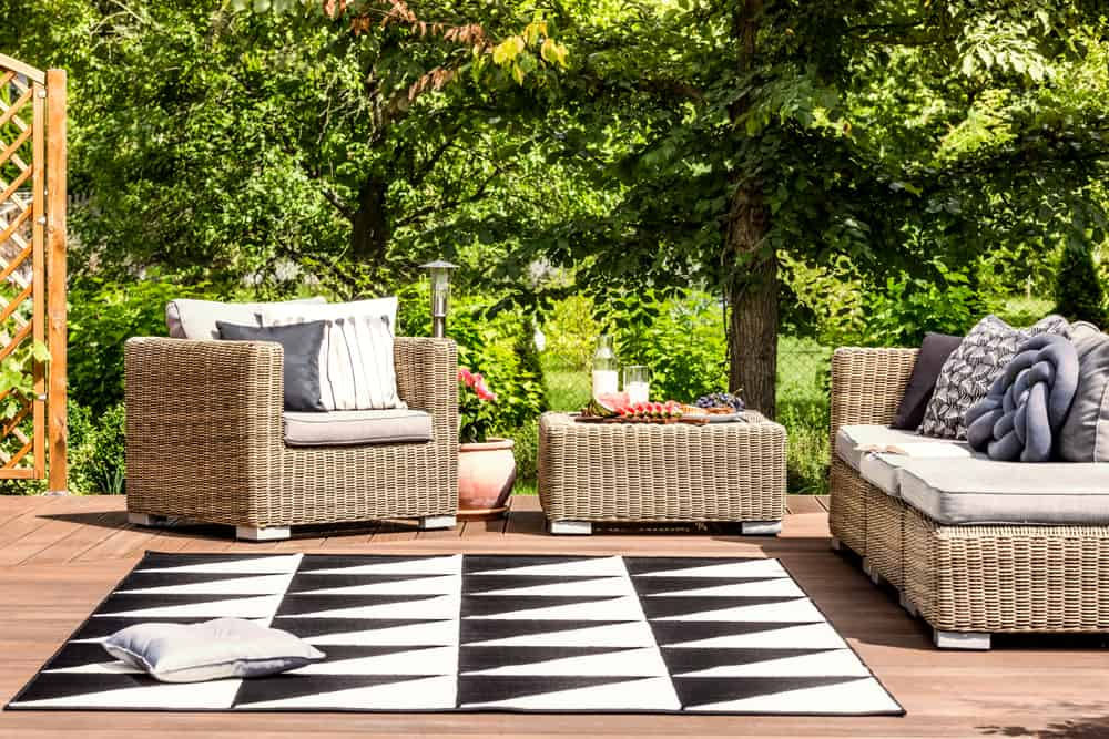 area rug and brown wicker