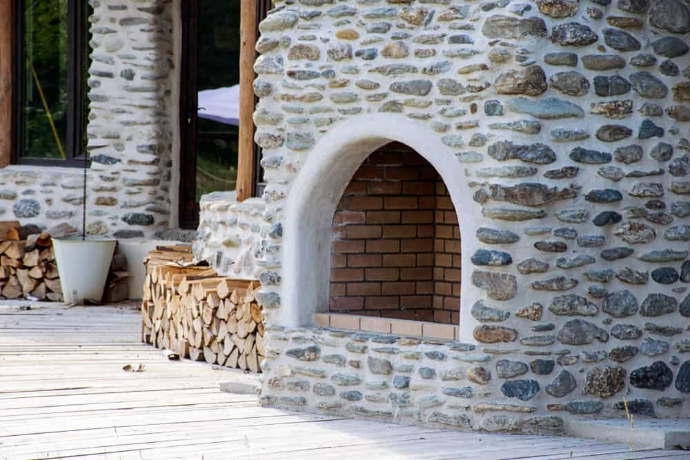 rounded stone and brick fireplace