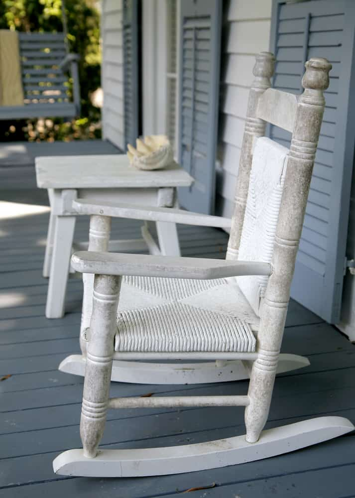 white rocking chair and side table