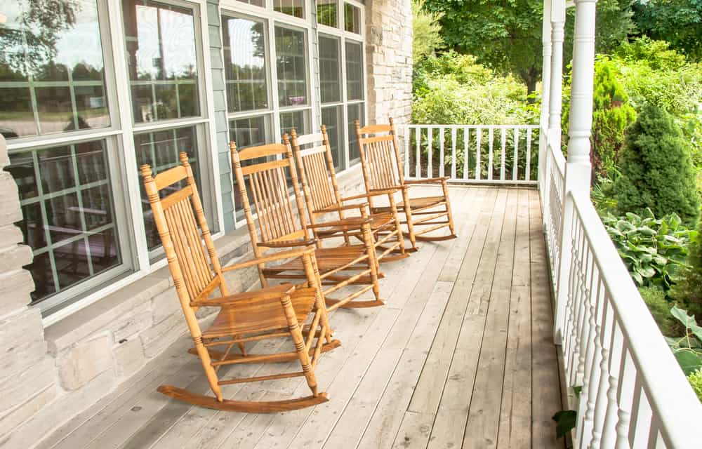 wood rocking chairs railing windows