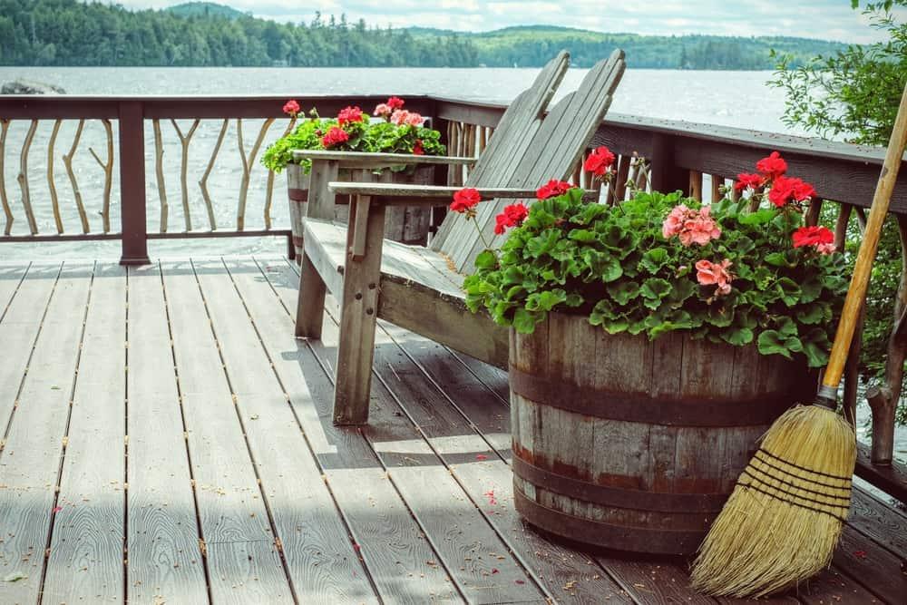 wood loveseat and barrel pots