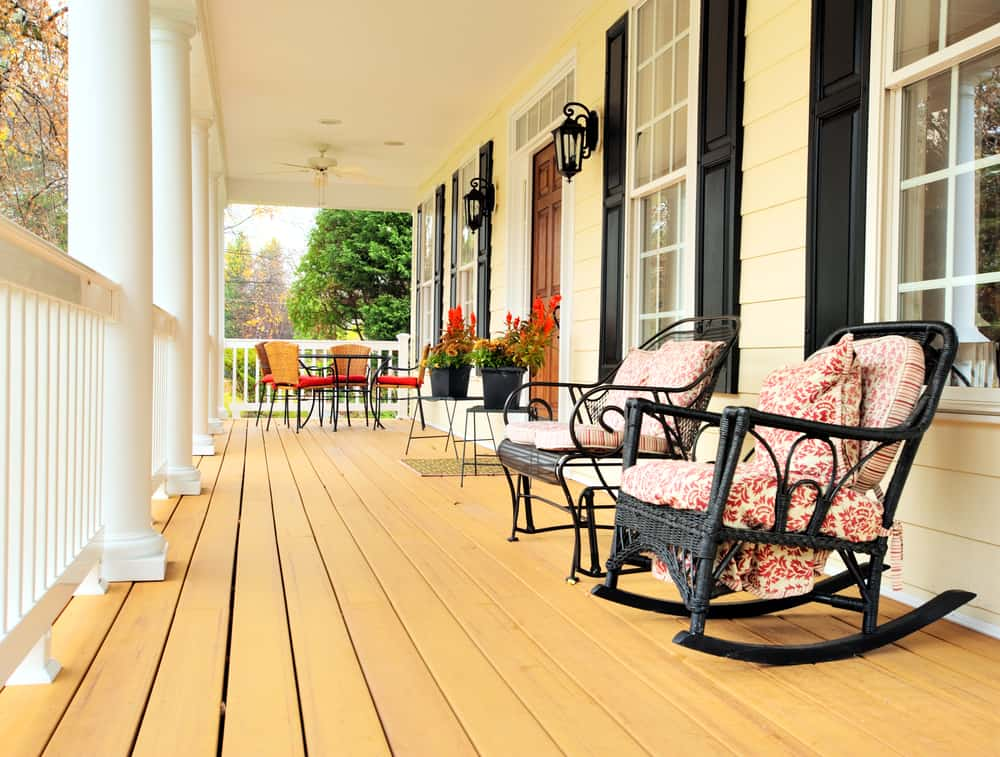 pink black rocking chairs porch