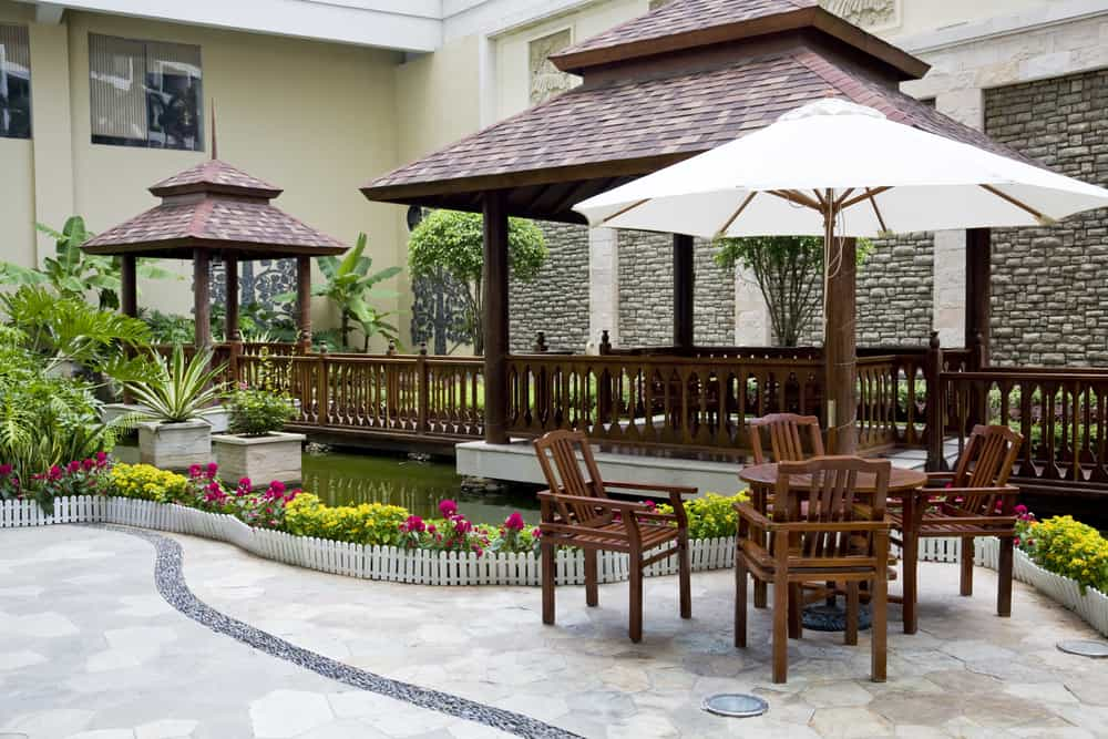 light stone gazebo and umbrella