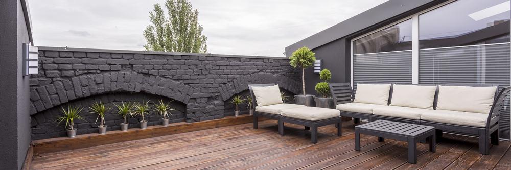 grey brick wall white furniture
