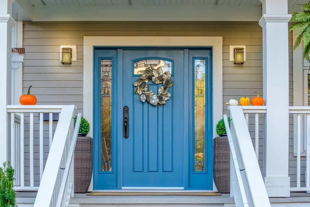 blue door with wreath