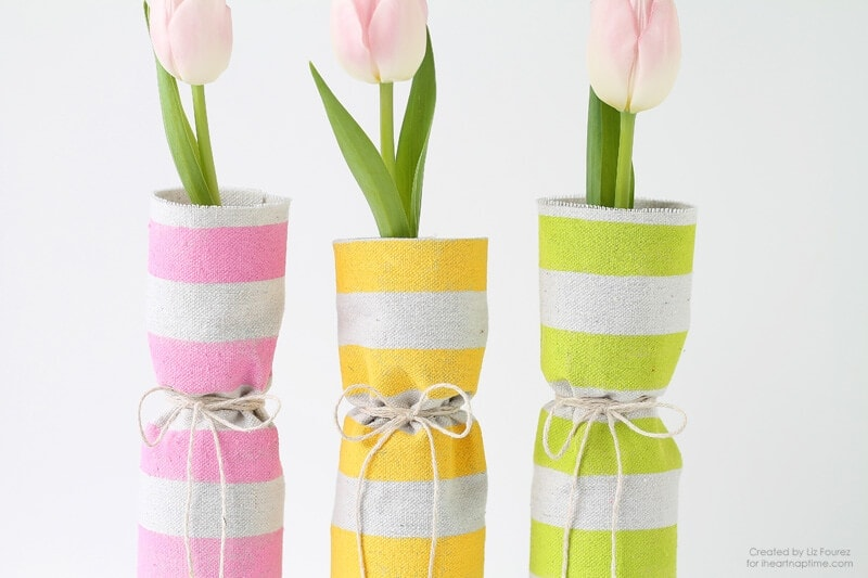 Fabric Covered Spring Vases When spring is in the air then it is time to start decorating too! These easy fabric covered spring vases are just what you need to add a few pops of color to any room. thesawguy.com