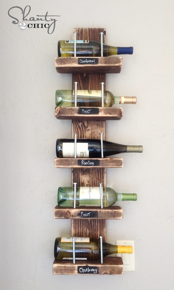 DIY Wine Rack Make this DIY wine rack and you will have a functional way to display your wine bottles that also looks incredible. Use a little bit of chalk and you can write what each kind is while adding to the design and appeal of the rack. thesawguy.com