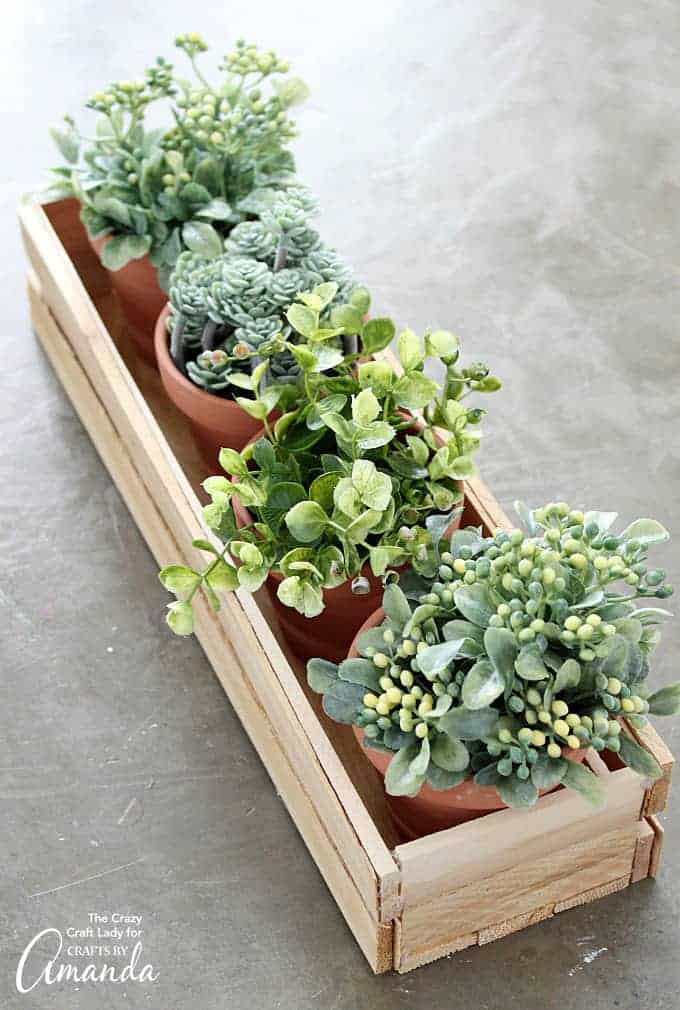 DIY Planter Box Making a wooden planter box is not only beautiful but really easy to make too. Add your favorite succulents or potted plants then you will have an incredible centerpiece! thesawguy.com