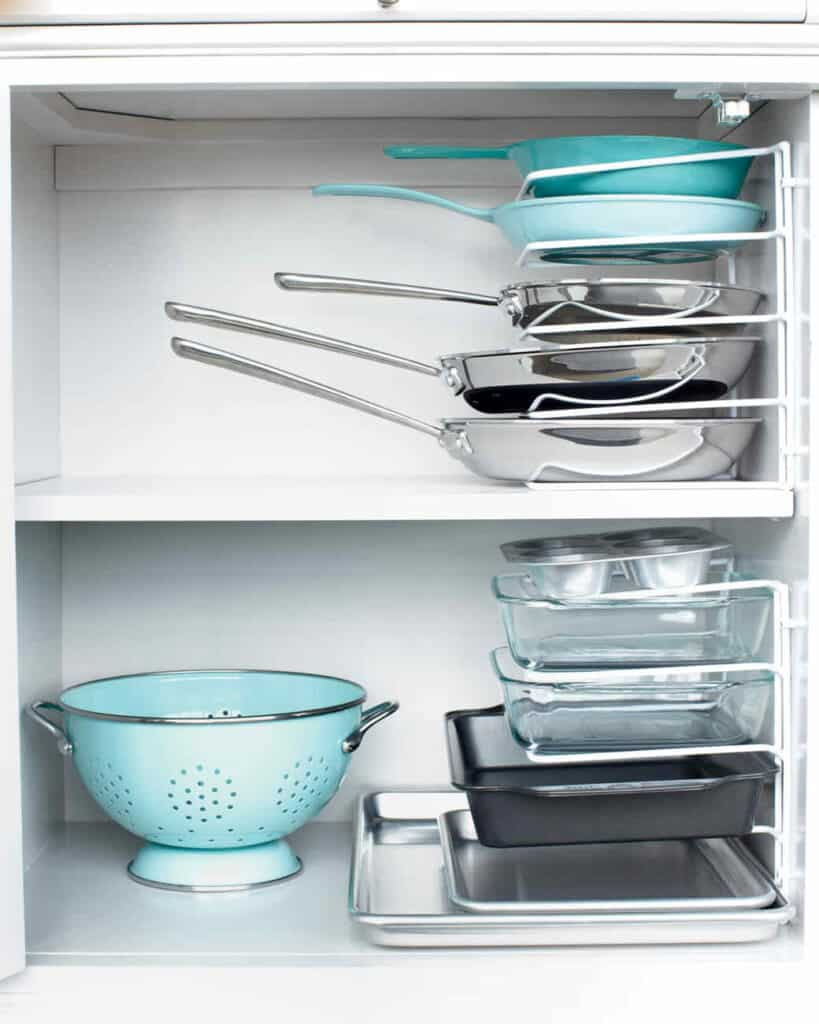 Cabinet Bakeware Storage Don't let those pesky pans and bakeware take over your cabinet space! Use these handy stacking pan organizers and it will feel like your space has doubled. Plus, you will love that every item has a special place and the overall look. thesawguy.com