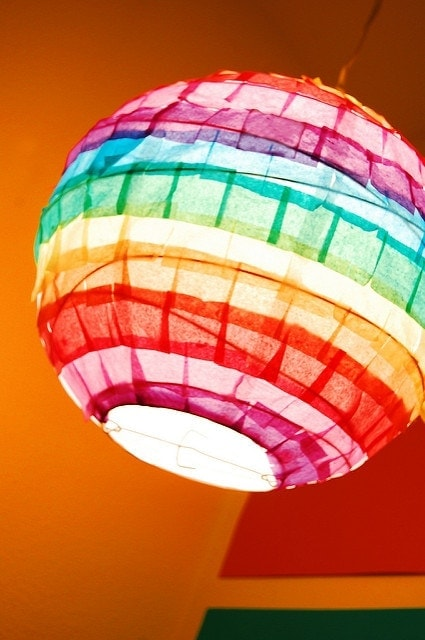 Rainbow Paper Lantern Tissue paper, glue and a paper lantern are all you need to decorate your own rainbow paper lantern. The result looks terrific and you can make it bright or more subtle depending on your preferences. Have a look! thesawguy.com