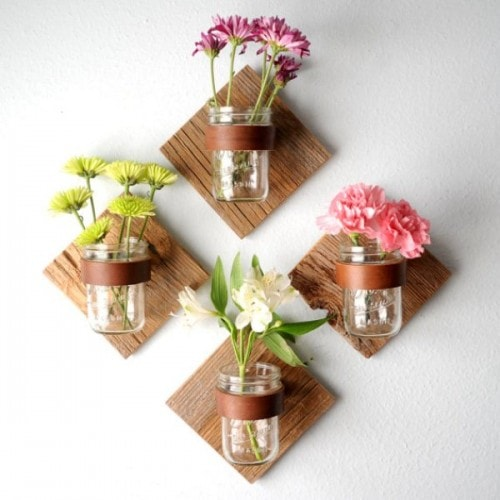 DIY Rustic Mason Jar Sconce Adding rustic sconces to your home will add the right amount of character and charm! Seriously, all you need is some leftover pieces of wood, a mason jar, and some leather strips! It can't get any easier than that! thesawguy.com