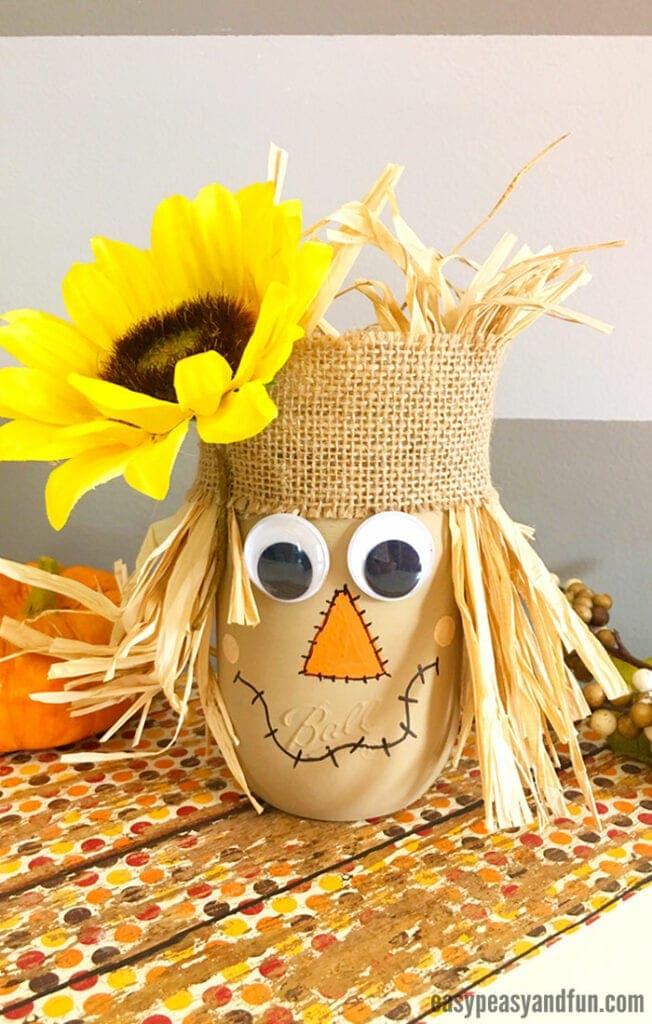 Scarecrow Mason Jar: These 25 Thanksgiving Crafts for Kids will get everyone into the thanksgiving spirit.
