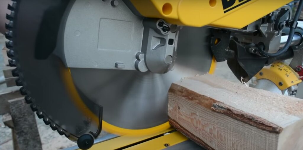 compound miter saw cutting wood